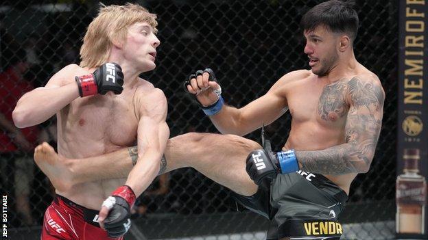 Luigi Vendramini of Brazil kicks Paddy Pimblett of England in their lightweight bout during UFC Fight Night event at UFC APEX on September 04, 2021