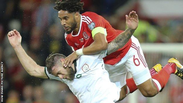 Wales captain Ashley Williams clashes with Daryl Murphy of Republic of Ireland in Cardiff in October 2017