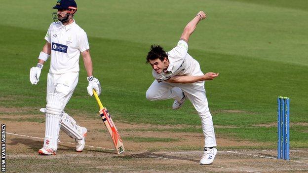 Tom Price bowls against Glamorgan
