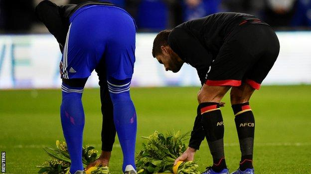 Captains Sol Bamba and Andrew Surman laid flowers in the middle of the pitch before kick-off