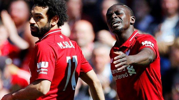 Mohamed Salah and Sadio Mane of Liverpool after Mane had scored his goal in the first half
