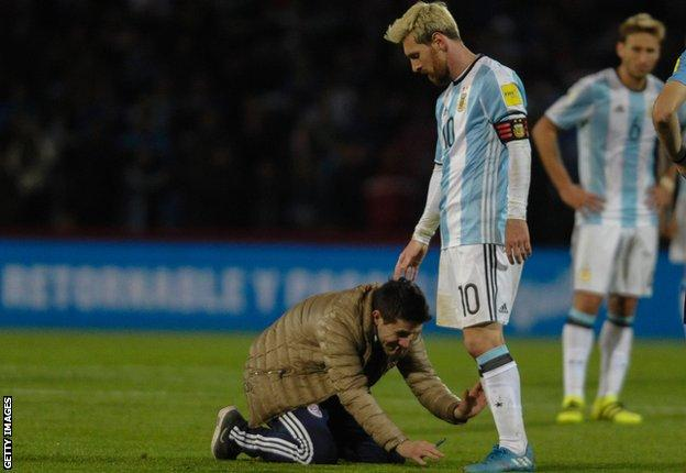 One Argentina fan attempts to kiss Messi's boots