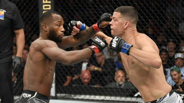 Leon Edwards (left) and Nate Diaz fight at UFC 263
