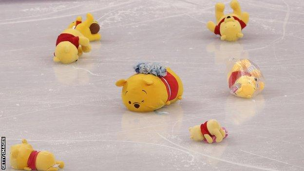 Winnie the Pooh toys on the ice