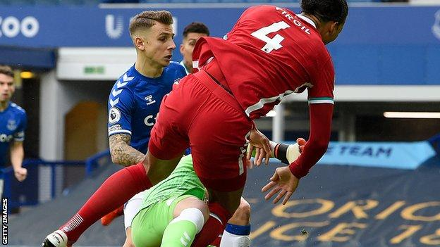 Jordan Pickford recklessly challenges Virgil Van Dijk during the Merseyside derby