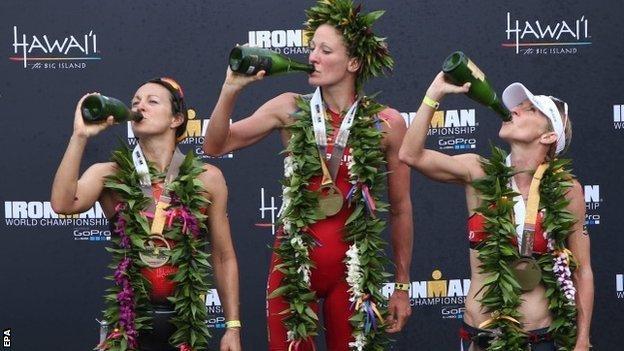 The top three women celebrate - Rachel Joyce (second) Daniela Ryf (first) and Liz Blatchford (third)