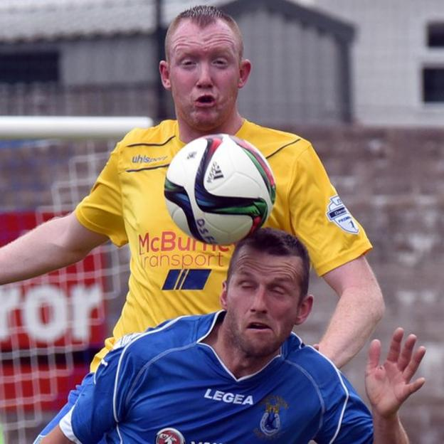 Ballymena defender Kyle McVey competes with Terry Fitzpatrick of Dungannon Swifts