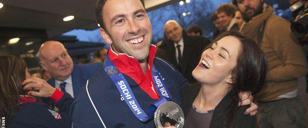 David Murdoch's wife Stephanie greets him as he returns from the Sochi Olympics with a silver medal