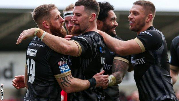 Toronto Wolfpack players celebrate a try