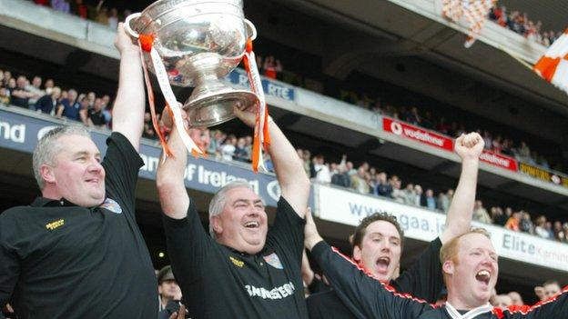Joe Maguire lifts the Sam Maguire trophy after Armagh's victory over Kerry in the 2002 All-Ireland final