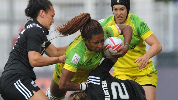Australia's Ellia Green is tackled by two New Zealand players