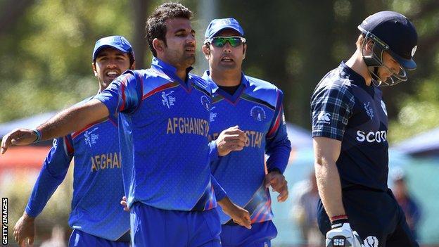 Afghanistan's Dawlat Zadran and Scotland's Richie Berrington