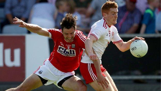 Cork defender Jamie O'Sullivan was black-carded for this this challenge on Peter Harte at O'Moore Park