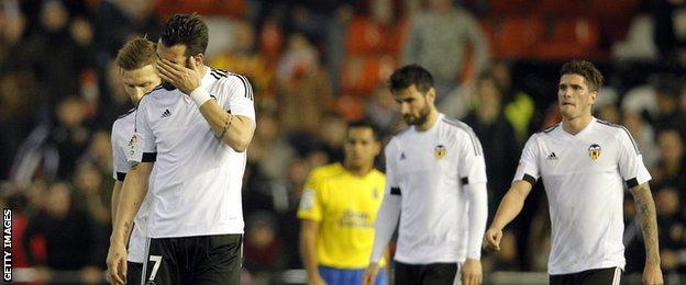 Valencia players look disheartened after another loss