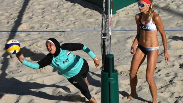 Egypt's Doaa Elghobashy dives for the ball during the women's beach volleyball