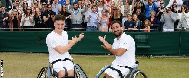 Gordon Reid (left) and Michael Jeremiasz join the fans at Wimbledon after losing in the doubles final