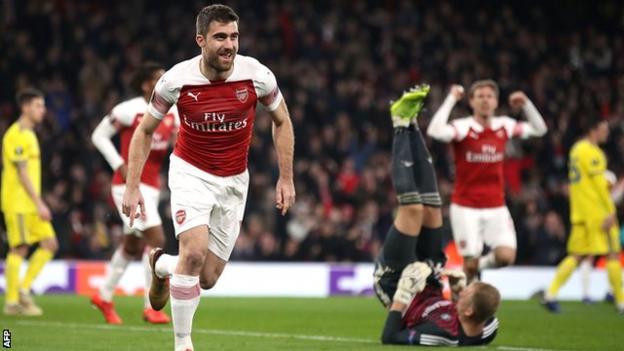 Sokratis celebrates scoring