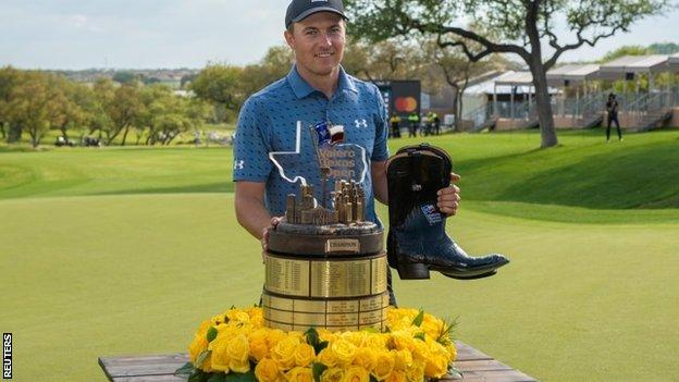 Jordan Spieth with trophy and a pair of boots after winning the Texas Open