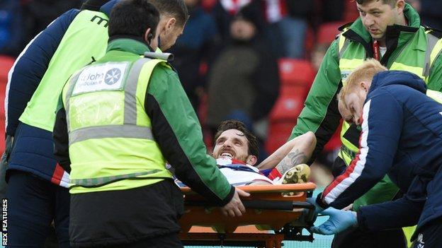 Joe Allen leaves on a stretcher