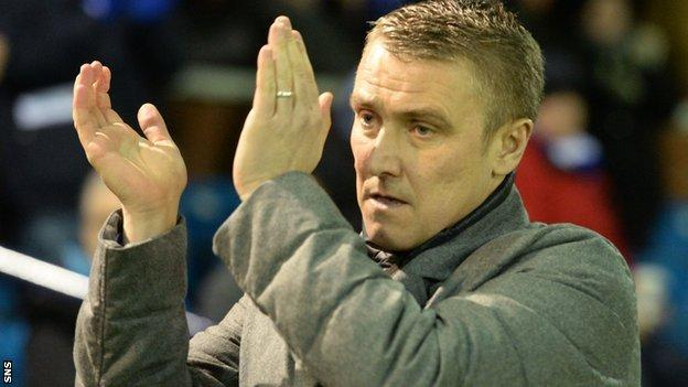 Kilmarnock boss Lee Clark applauds his team's fans