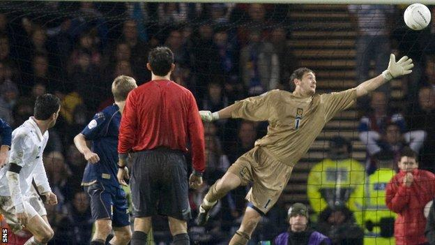 Christian Panucci (left) watches as his header beats Craig Gordon in Italy's win over Scotland in 2007