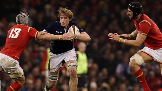 Jonathan Davies (left) and Luke Charteris (right) tackle Scotland's Jonny Gray