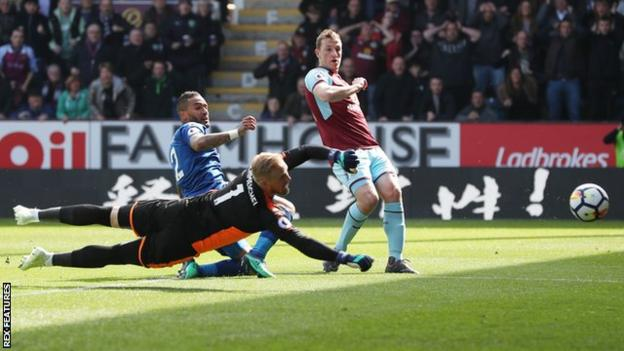 Chris Wood reached double figures in the Premier League by scoring against his old club