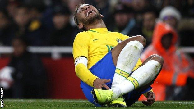 Neymar goes down injured