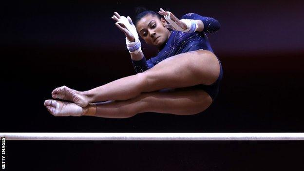 Becky Downie competing on the uneven bars at the World Championships in Doha