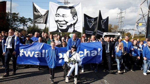 Fans walk in memory of the late chairman