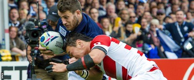 Tommy Seymour takes on the Japan defence for Scotland at the 2015 World Cup