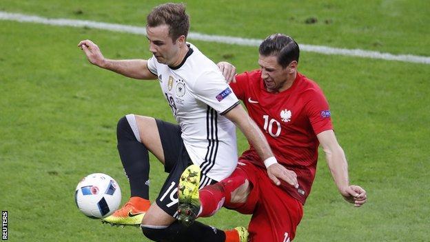 Poland's Grzegorz Krychowiak (right) in action with Germany's Mario Gotze