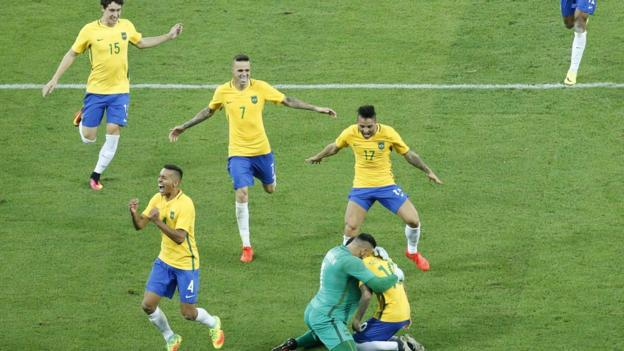 Neymar and his Brazil team-mates celebrate victory in the Olympic football final.