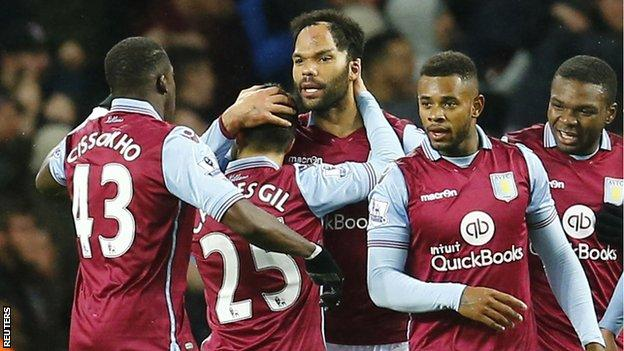 Aston Villa players celebrate taking the lead against Crystal Palace