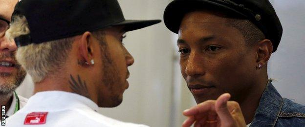 Mercedes driver Lewis Hamilton (left) talks to singer Pharrell Williams during the Singapore Grand Prix second practice session
