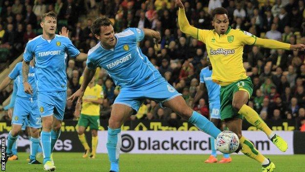 Norwich City midfielder Josh Murphy (11) battles for the ball with Burton Albion defender Ben Turner