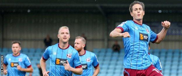 Josh Morris (right) celebrates a goal against Gillingham