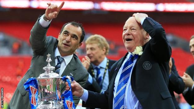 Roberto Martinez holds the FA Cup trophy with Dave Whelan after Wigan's 1-0 FA Cup final win against Manchester City in 2013