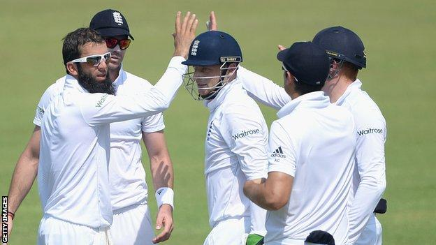 Moeen Ali (left) celebrates a wicket