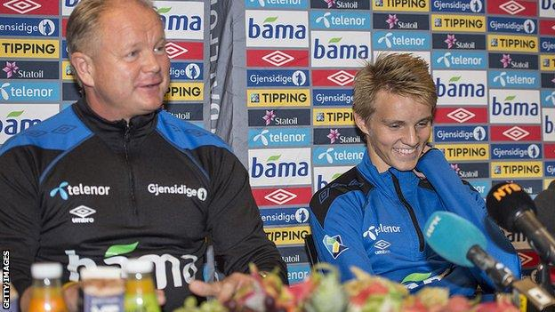 Martin Odegaard and Norway head coach Per Mathias Hoegmo speak at a press conference in 2014 shortly before the then 15-year-old's international debut