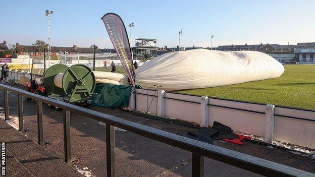 Tents were set up to stop the pitch from freezing