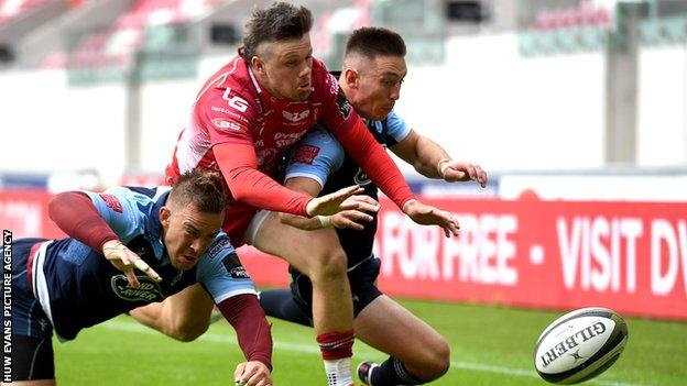 Scarlets wing Steff Evans scores his second try against Cardiff Blues
