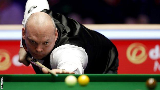 Stuart Bingham takes a shot during the Masters semi-final against DAvid Gilbert