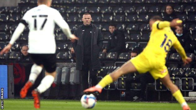 Wayne Rooney on the sideline as caretaker Derby manager