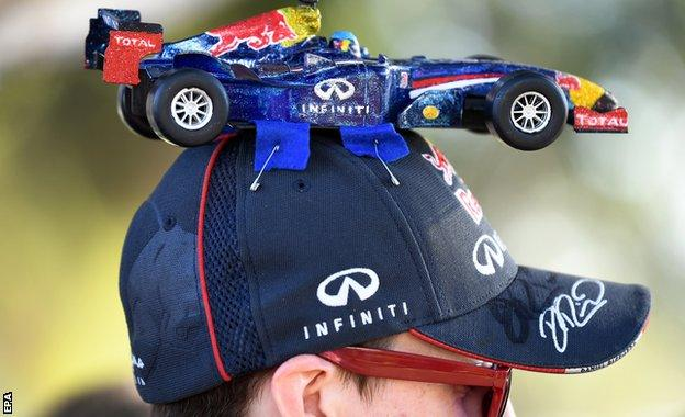 F1 fan is seen with a Red Bull hat