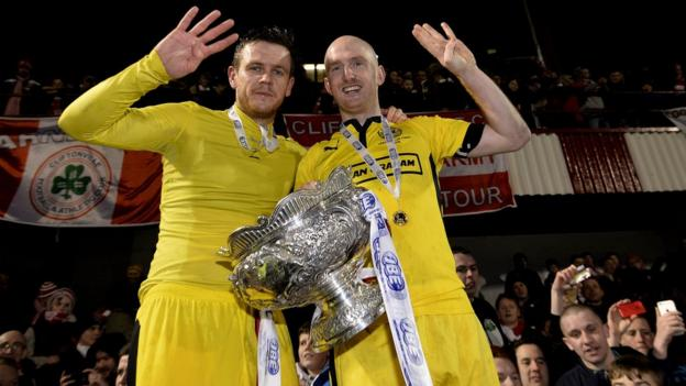 Cliftonville's Jaimie McGovern and Ryan Catney provide a reminder that the north Belfast club have won the League Cup for four successive seasons
