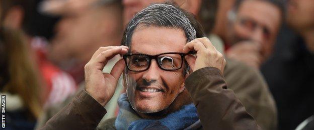 A Chelsea fan wears a Jose Mourinho mask