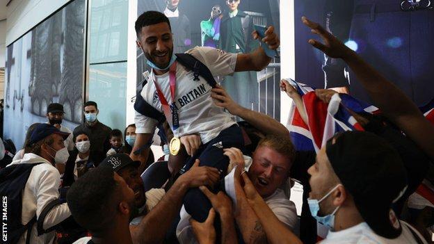 Boxer Galal Yafai is congratulated at Heathrow Airport.