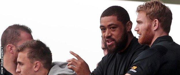 Taulupe Faletau watches from the stands
