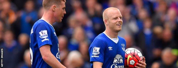 Steven Naismith (right) trots off with the match ball against Chelsea